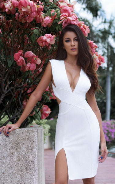 beautiful model in white deep cut bandage dress