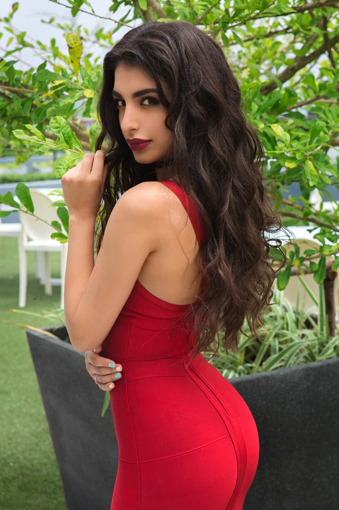 tight red bandage dress showing off booty