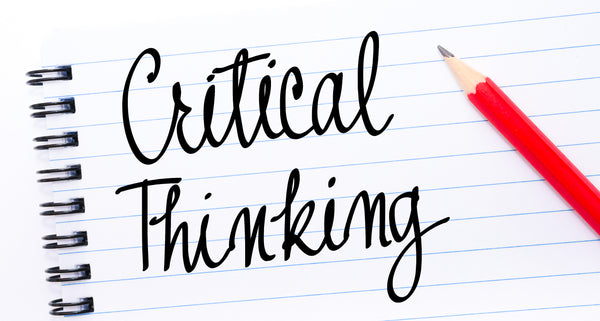 Critical Thinking written on notebook page