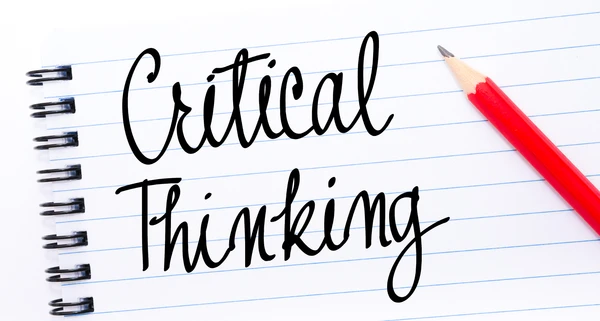 Critical thinking written on notepad