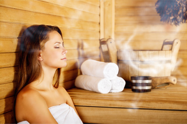 Young woman relaxing in spa sauna