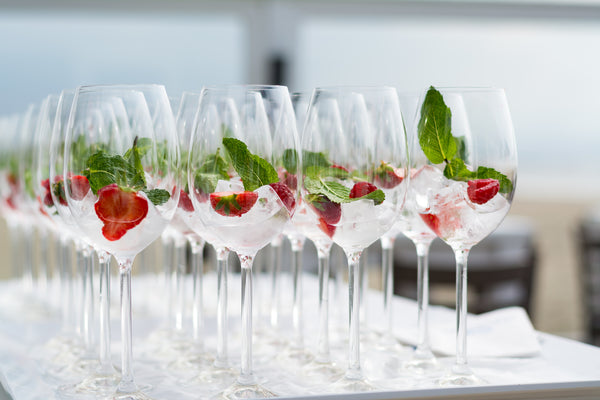 cocktail glasses with strawberries and ice