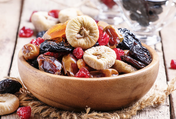 Healthy food: mixed dried fruits in wooden bowl