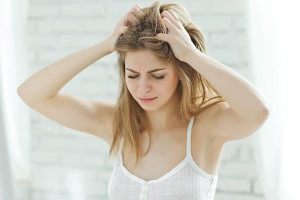 frustrated woman pulling at her hair