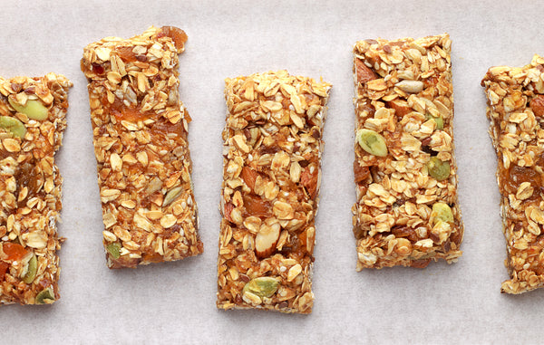 Homemade granola bars on white baking paper