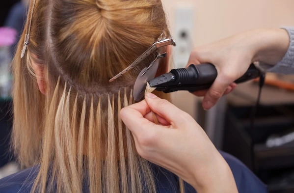 Girl having hair extensions fitted