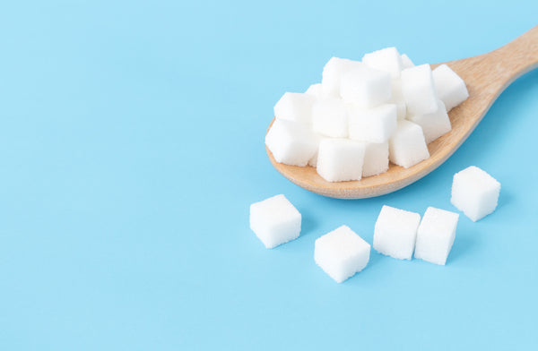 sugar cubes on a spoon
