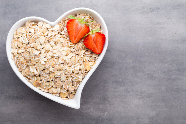 oats in a heart shaped breakfast bowl