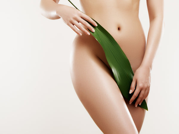 woman covering pubic area with aloe leaf depicting freshness and cleanliness