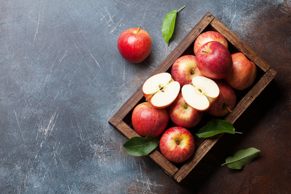 red apples in a wooden box