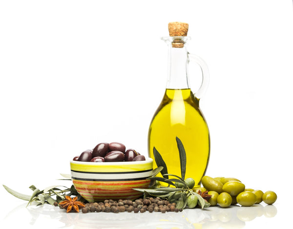 bottle of olive oil with unpressed olives