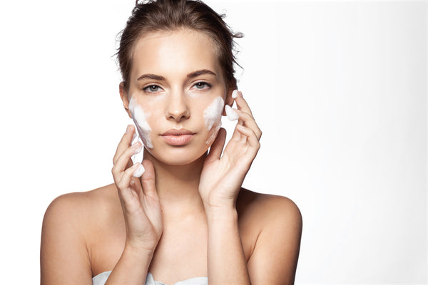 girl cleaning face with cleanser