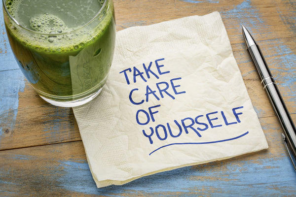 take care of yourself - written on a napkin near a healthy drink