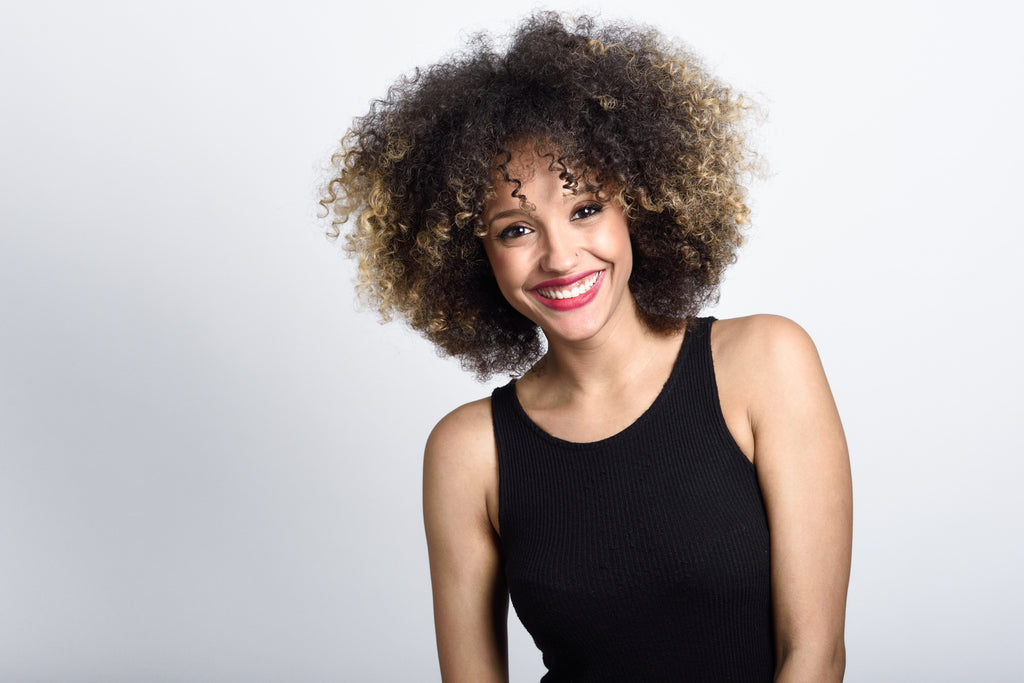 smiling girl in afro hairstyle