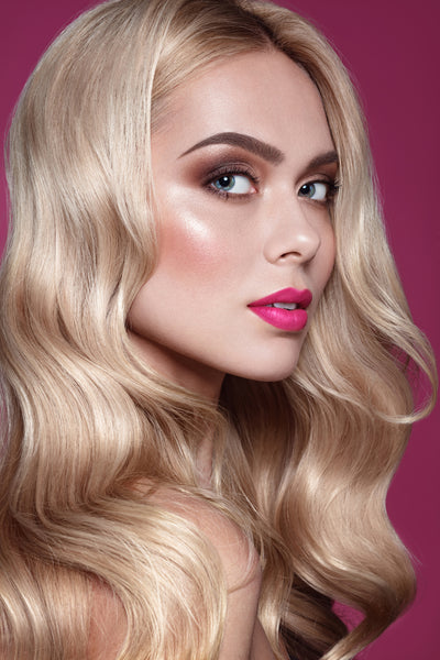 Close up portrait of fashion blonde haired model with chandelier layers hairstyle