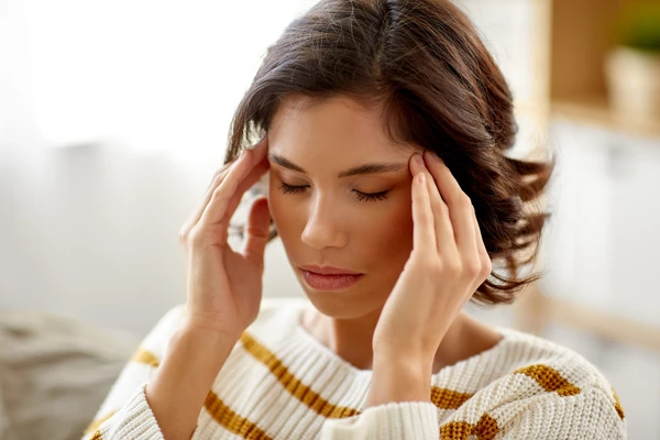 Woman holding her head in stress