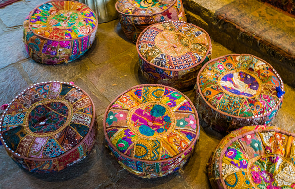 colorful meditation pillows on the floor