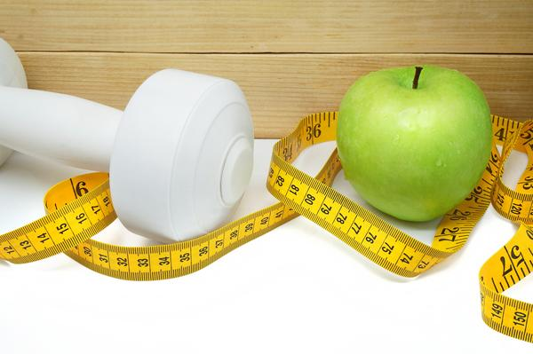 image of dumbbell, apple and tape meaure