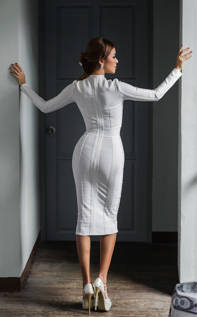 white cut out long sleeve bandage dress - rear view on model