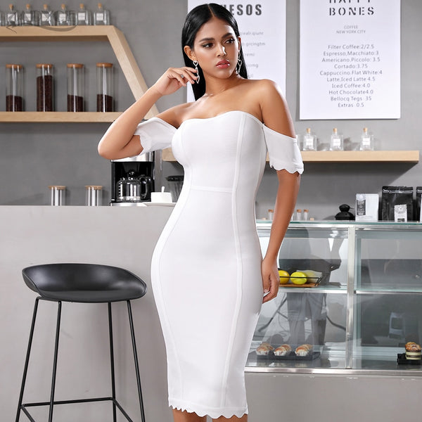 white short sleeve off shoulder bandage dress - side view on model