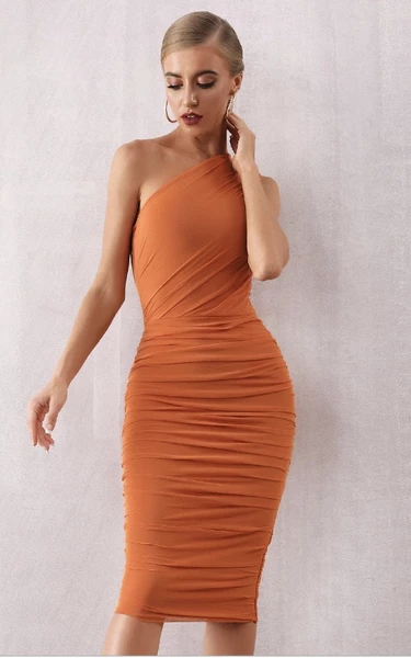 rust orange mesh bandage dress - front view on model