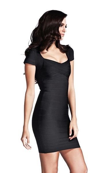 black cap sleeve bandage dress - side view on model