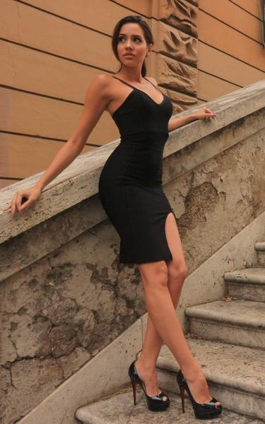 black bodycon slip dress - side view on model