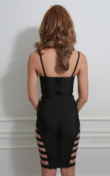strappy caged bandage dress - back view on model