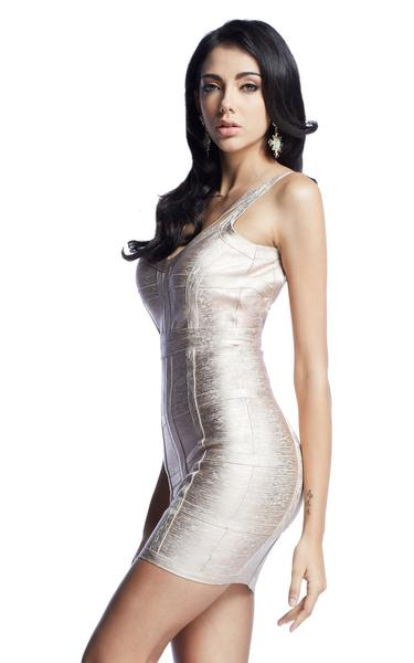 side of rose gold bandage dress on model