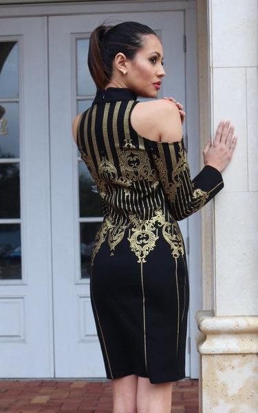 black and gold long sleeve bandage dress - back view on model