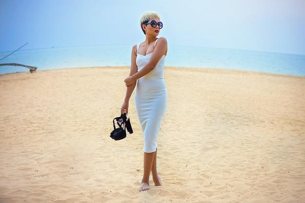model on beach wearing a bandage bodycon dress during the daytime