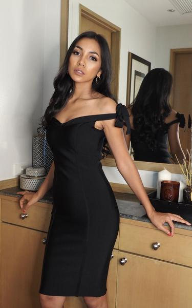 black off shoulder bow knot bandage dress on model - front view