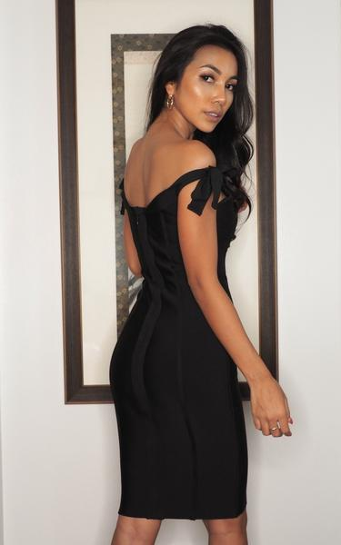 black off shoulder bow knot bandage dress on model - back view