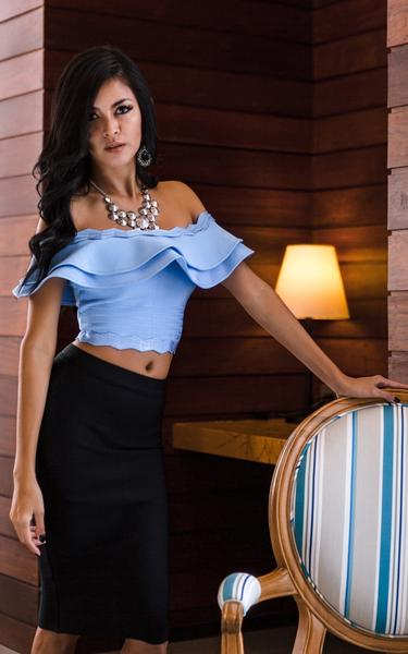 blue crop  top and black skirt in bandage material