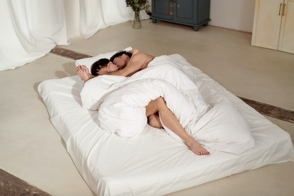 Couple together on a mattress