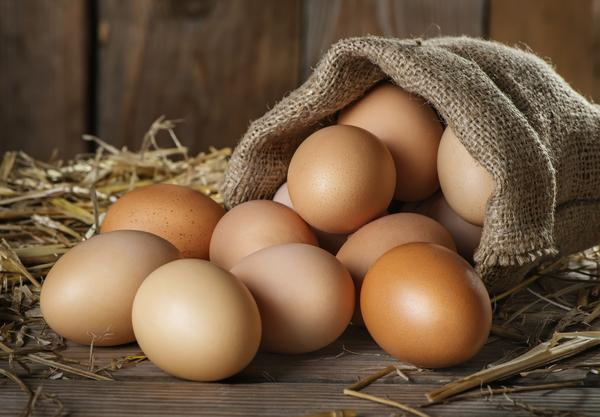 whole eggs in shell and egg basket