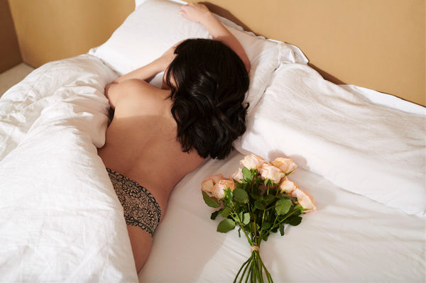 Girl in bed with roses