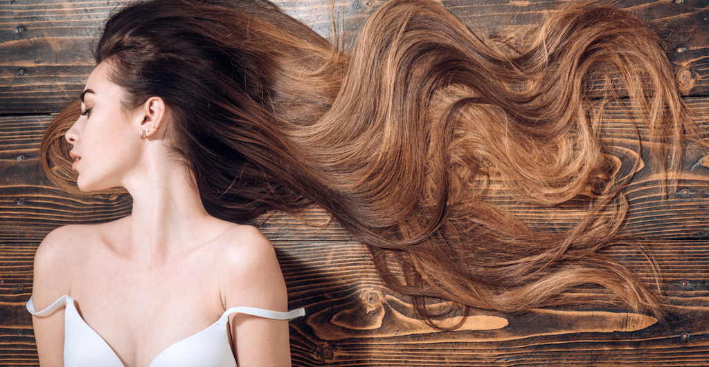 Beauty hair Salon. Woman with long beautiful hair. Fashion haircut. Beauty girl with long and shiny wavy hair. Trendy haircuts. Long healthy hair
