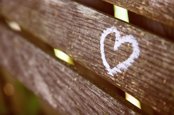 Heart chalked on a park bench