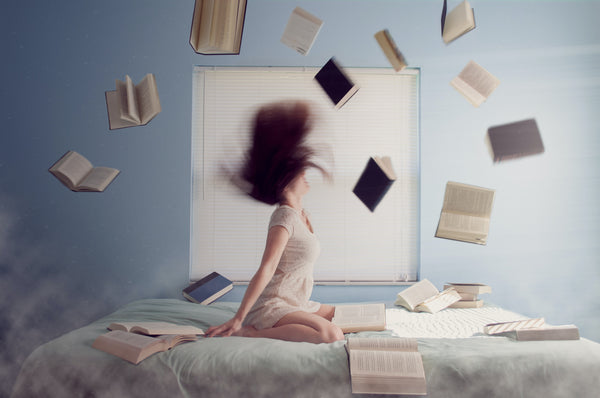 Girl throwing books in stress