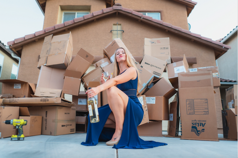 Confident woman with packing boxes