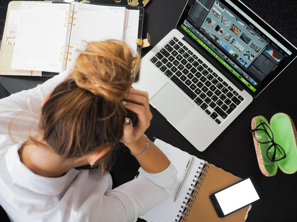 Girl stressed working at computer