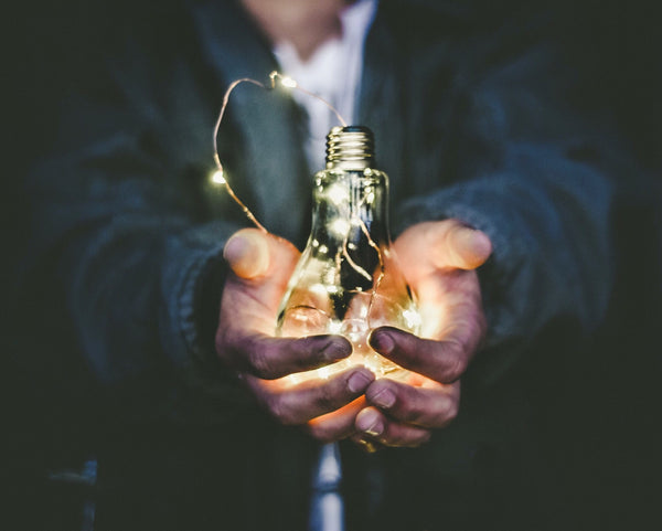 Man holding idea lightbulb in his hand