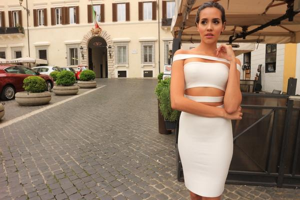 model wearing white strapless dress in stylish location
