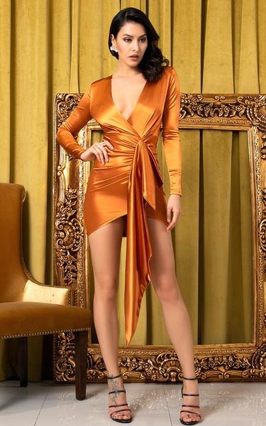 rust colored bodycon wrap dress on model