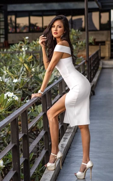 white off shoulder bandage dress on model - side view