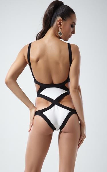 white and black one piece bandage swimsuit - back view on model