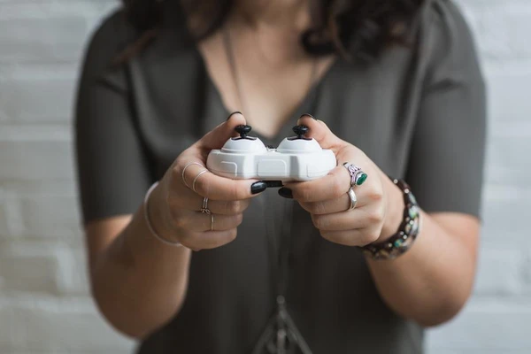 Girl holding a gamer remote
