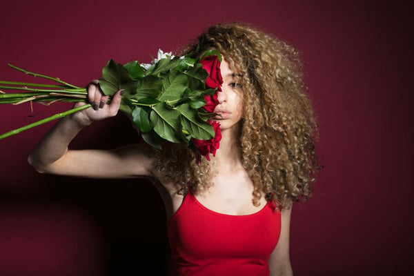 A woman with curly healthy hair