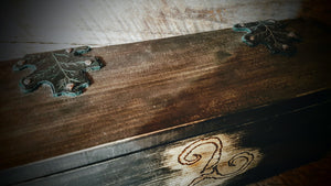 Top view of rustic alter box with oak leaf hinges and handmade copper pins.